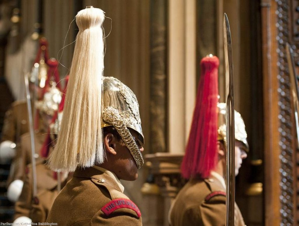 Household Cavalry stand guard in parliament for the Queen's Speech