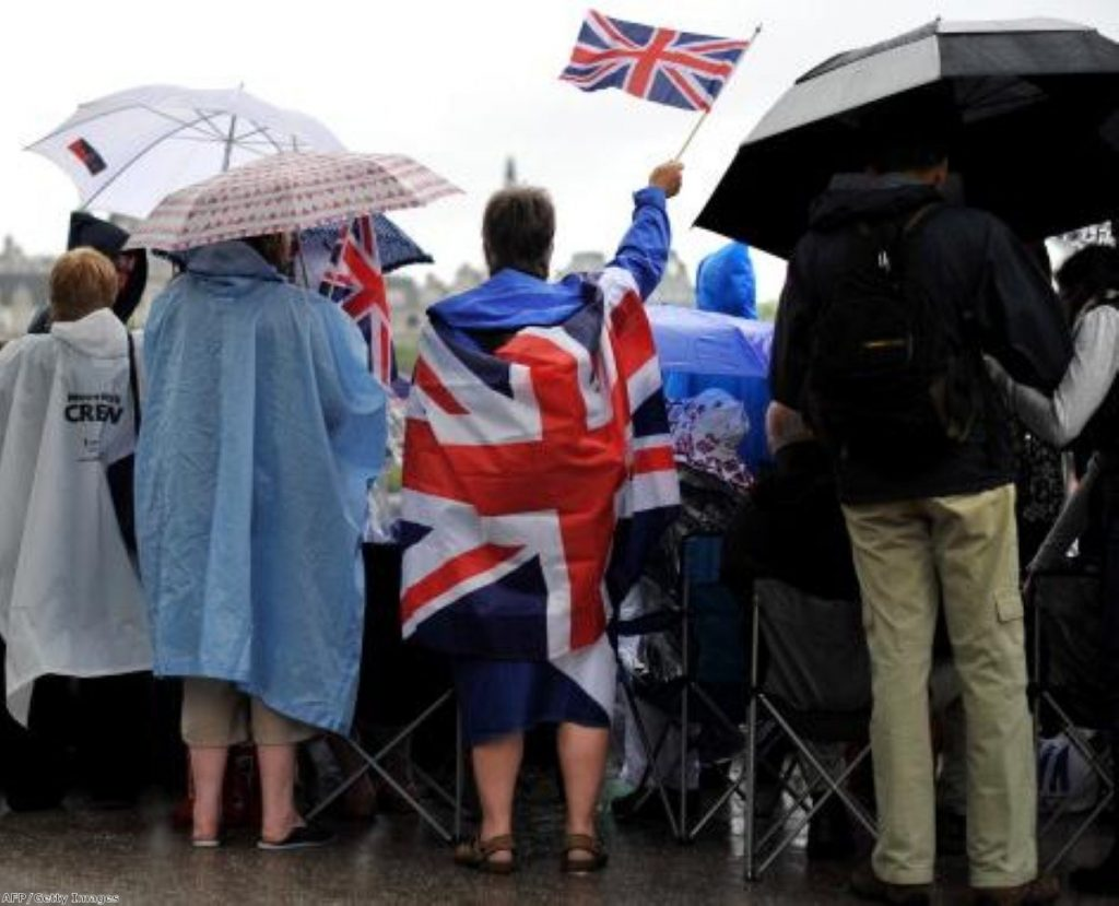 Revellers stay cheerful despite the Diamond Jubilee weather
