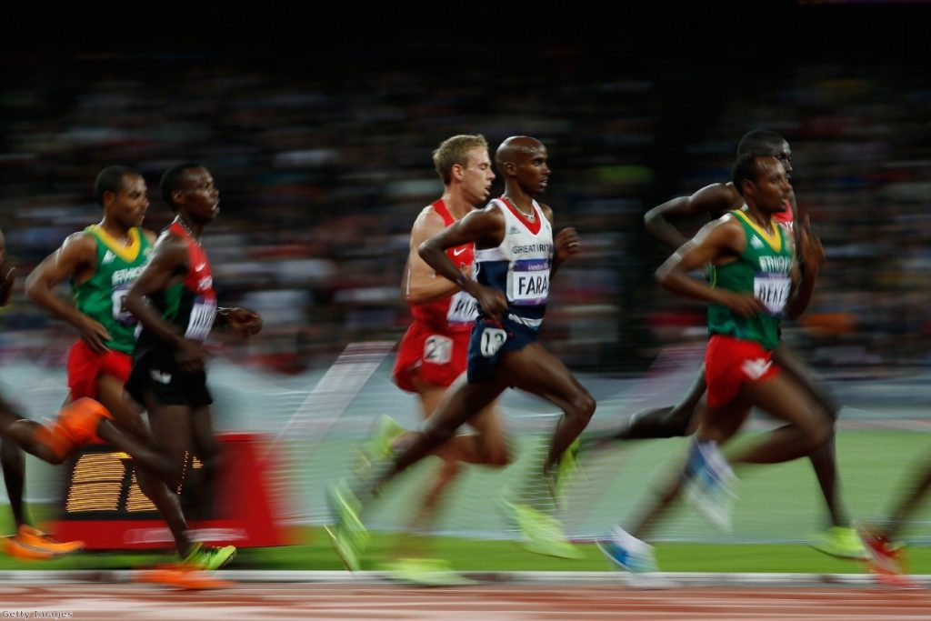 Mo Farah overtakes opponents during a spectacular 10,000 metre race yesterday.