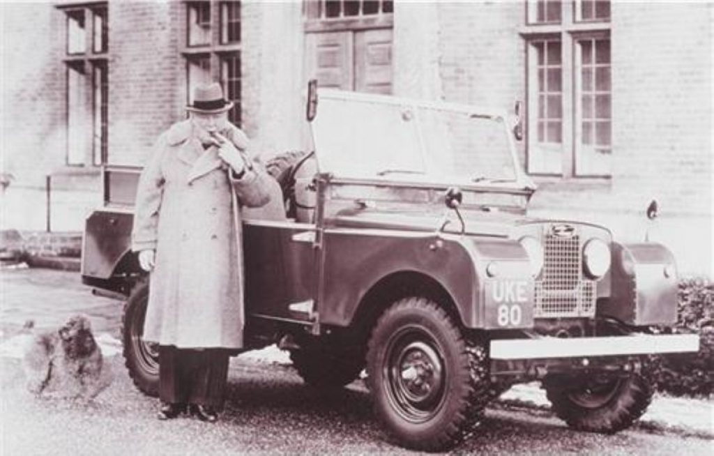 Churchill by his vintage Land Rover