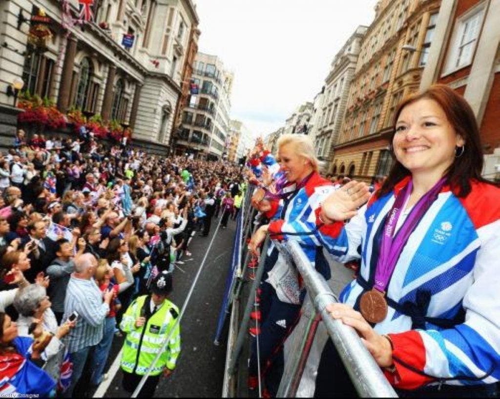 Members of Team GB's women's hockey team greet the crowds during the Olympic parade