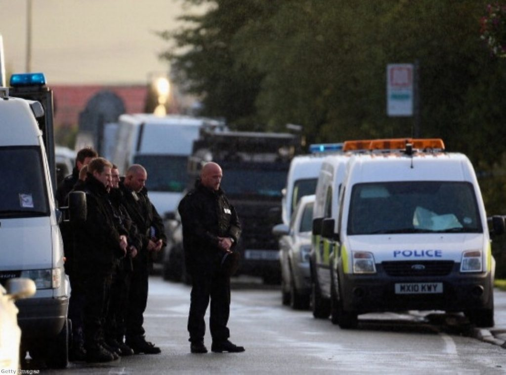 Police pay their respects as the body of a female police officer leaves the scene in Hattersley, Tameside