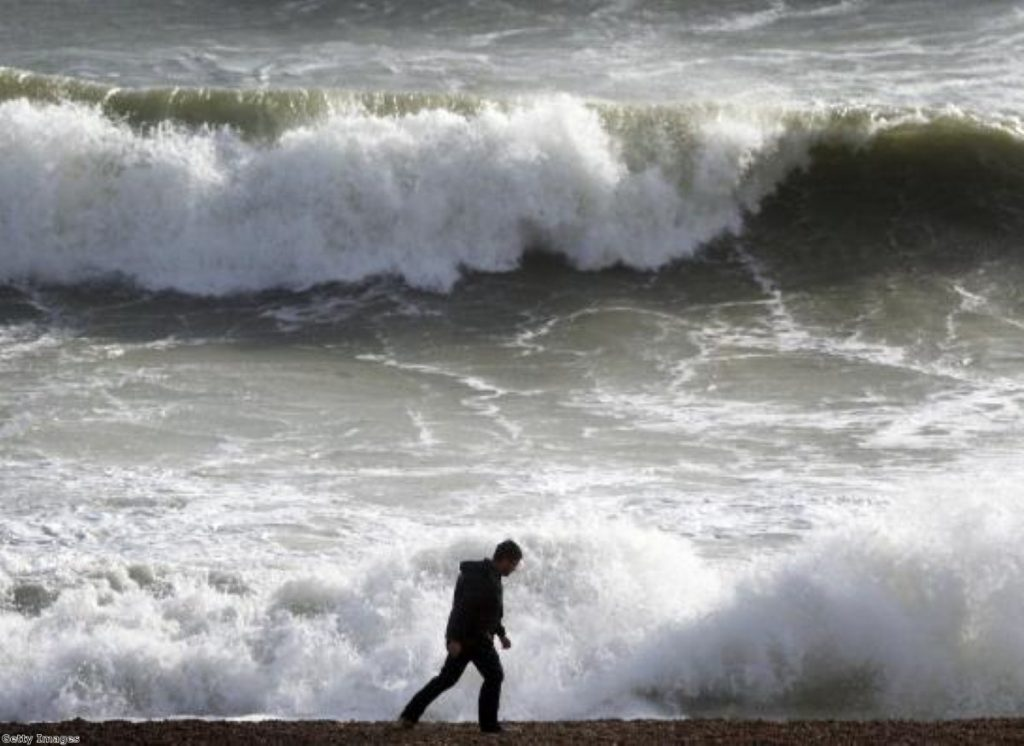 Hint: The man is the Lib Dems. The waves are the voters. Or something.