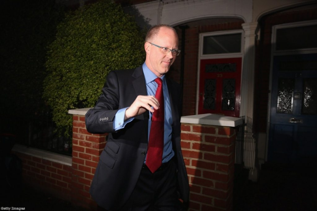 BBC director general George Entwistle leaves his home this morning with a press pack outside his front door.