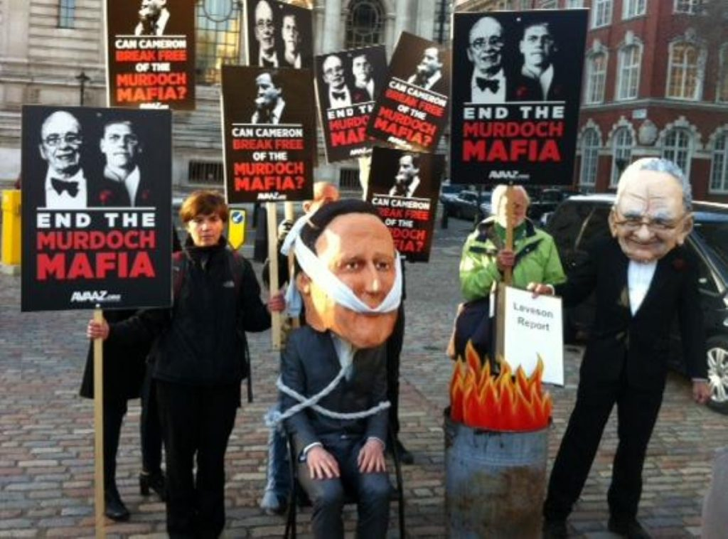 Protesters outside the QE2 Centre on Thursday, where Leveson launched his report. Cameron opposes it