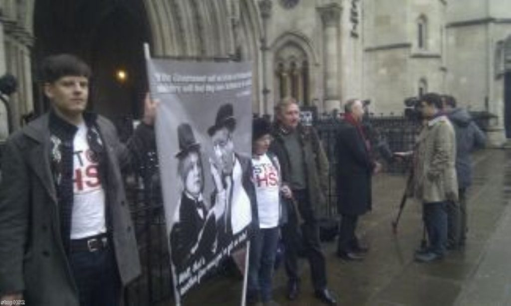 Protesters gathered outside the Royal Court of Justice