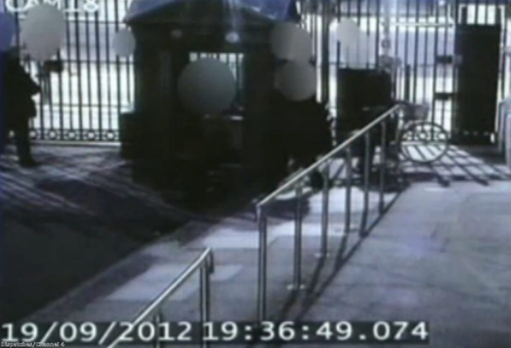 CCTV footage shows Andrew Mitchell leaving Downing Street with his bicycle by the side gate