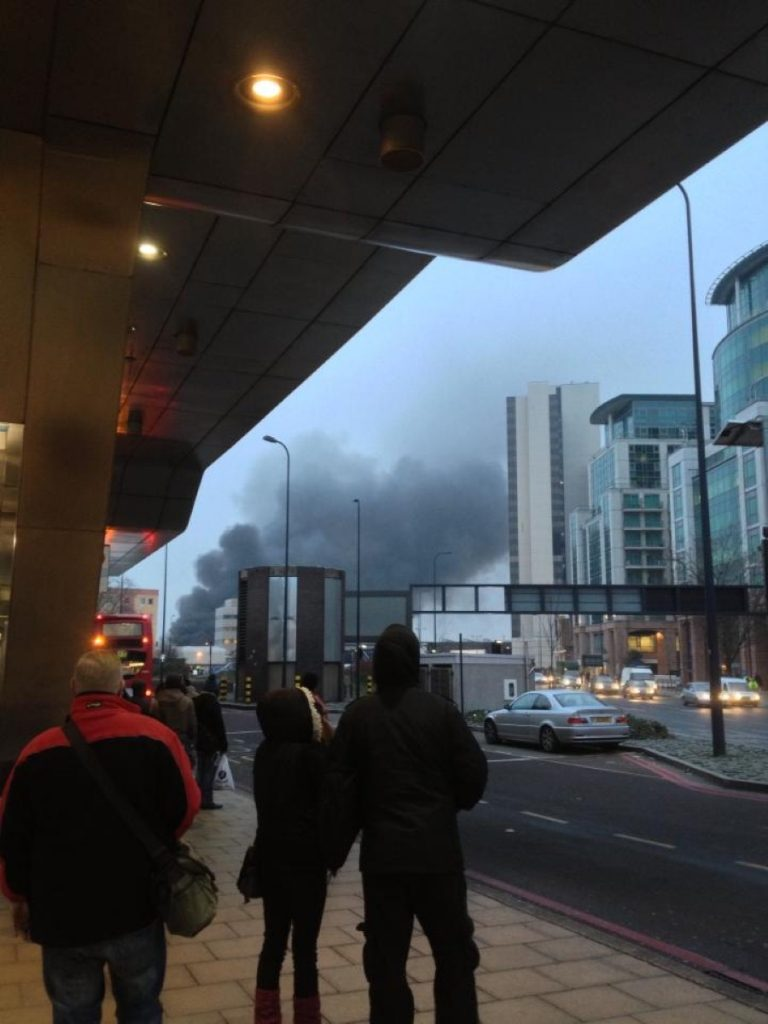 Commuters gaze at the smoke billowing from the crash in central London this morning. Photo credit: Zammurad Salam