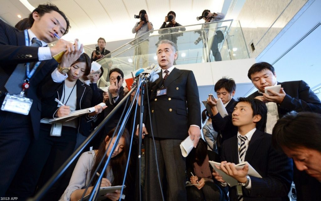 Amid a global crisis situation, Takeshi Endo, public relations manager of Japanese plant construction company JGC, answers questions in suburban Tokyo. The firm confirmed the safety of three of its Japanese staff and one Philippine employee in Algeria but the whereabouts of 74 other staff of various nationalities are unknown.