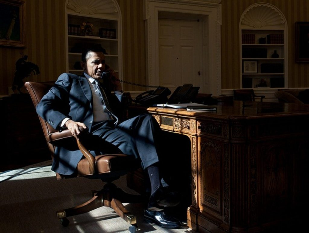 Morning winter sunlight floods the White House as Barack Obama talks on the phone with British prime minister David Cameron
