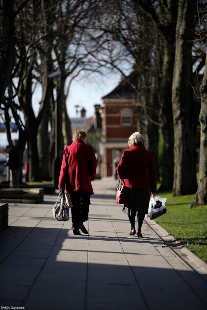 Elderly ladies walk in the sunny town centre in Eastleigh as candidates campaign.