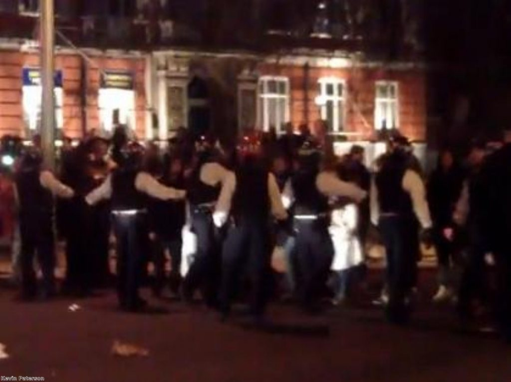 Video footage shot at the scene shows police in a standoff with those celebrating Thatcher's death