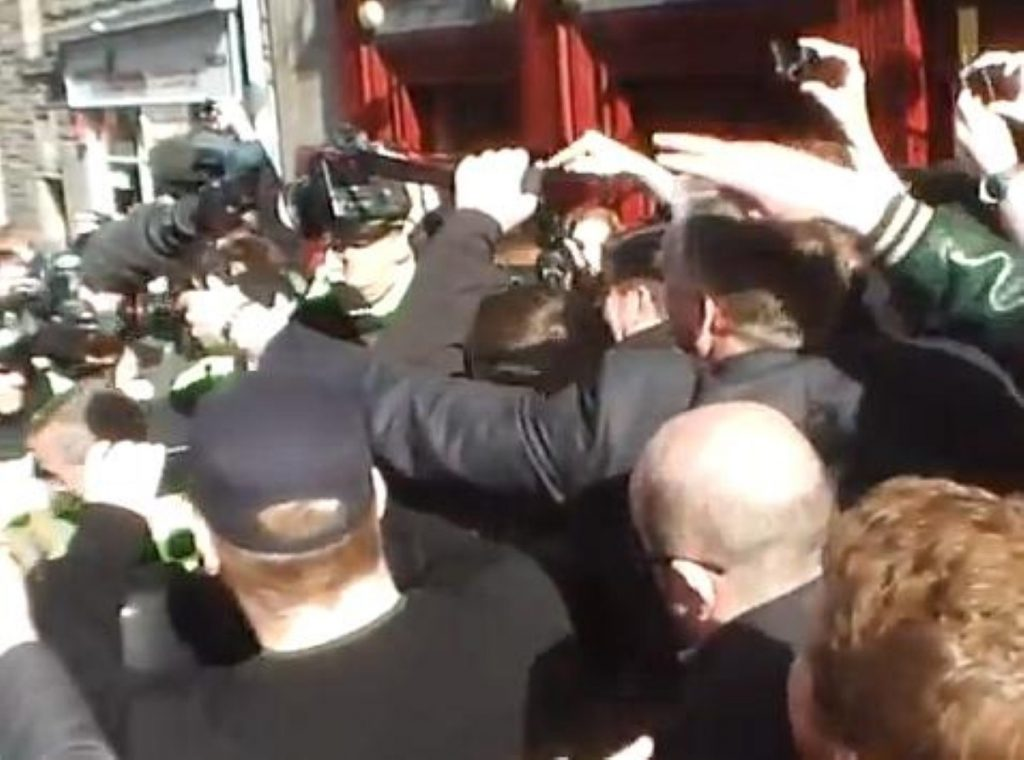 Nigel Farage makes his escape from the Canons' Gait pub in Edinburgh