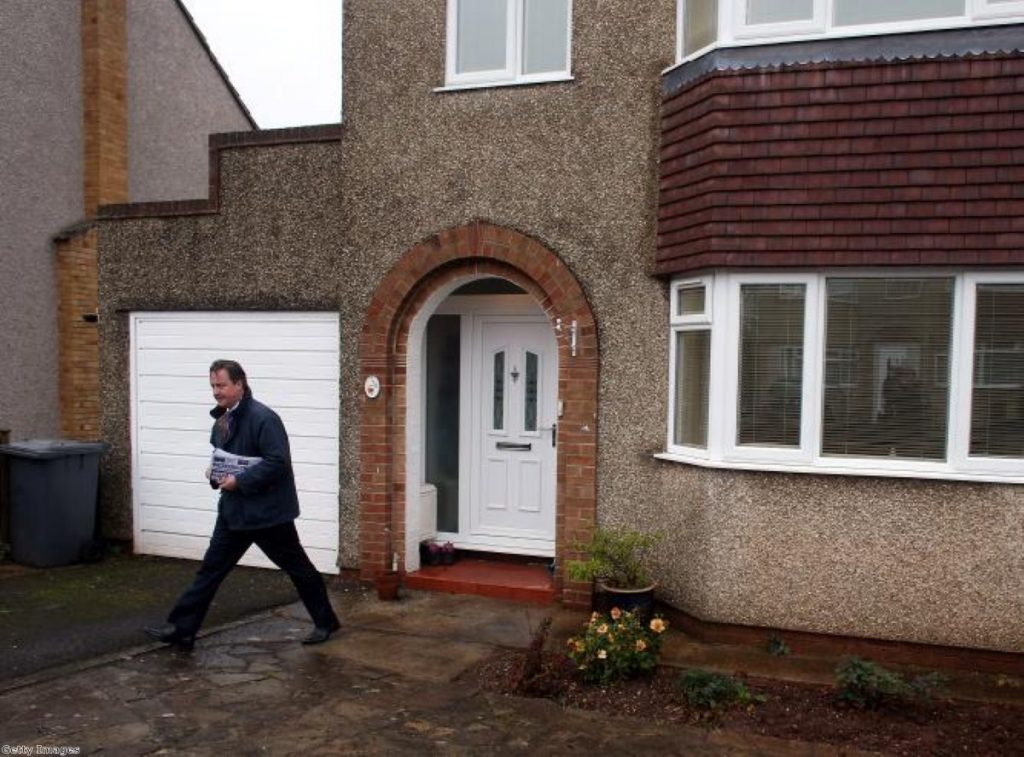 Back to the grassroots: David Cameron on the doorstep. He insisted he was a 'volunteer' in the Conservative party