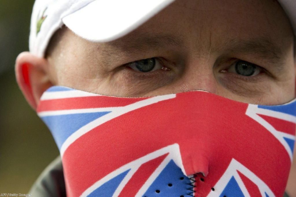 An EDL supporter looks on during a protest. Anti-fascists are worried the group could grow in coming days