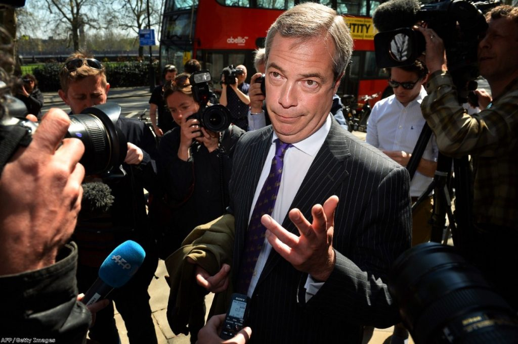 Farage struggles to speak to the press during a walk about in London