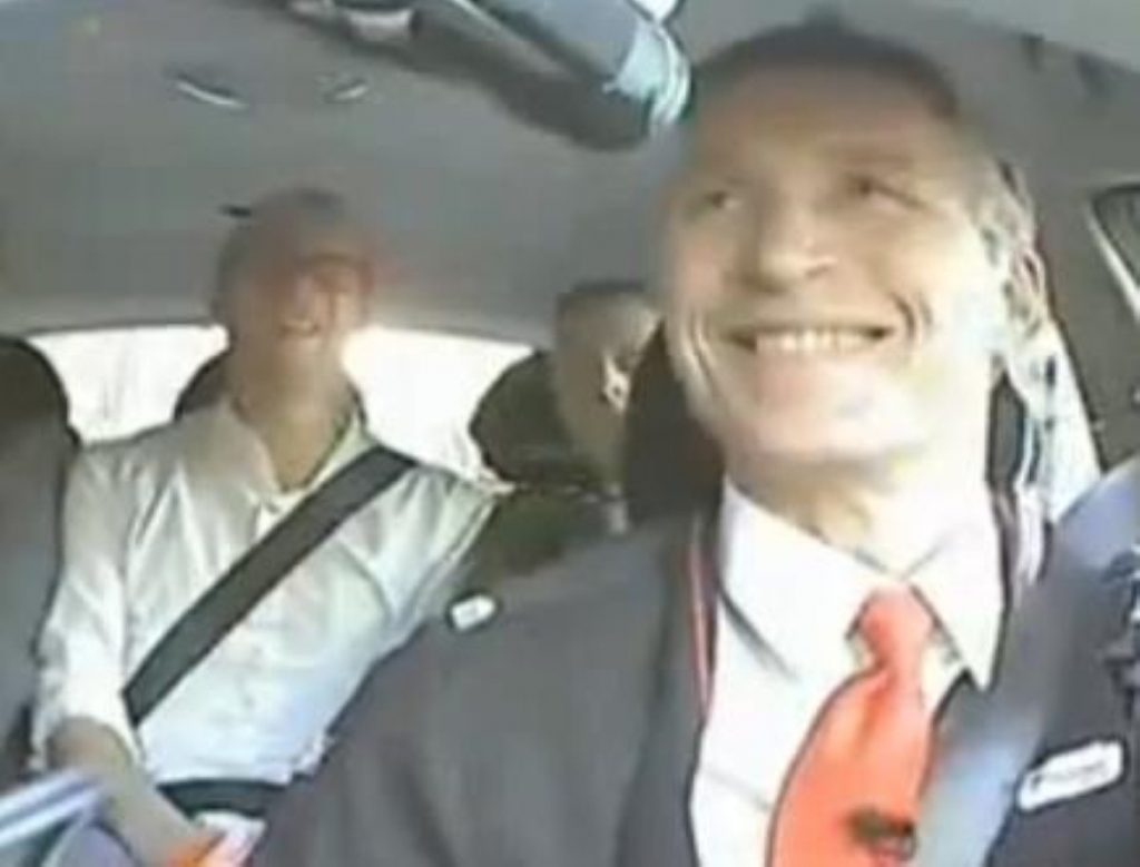 Jens Stoltenberg, Norway's prime minister, gets behind the wheel to talk to voters
