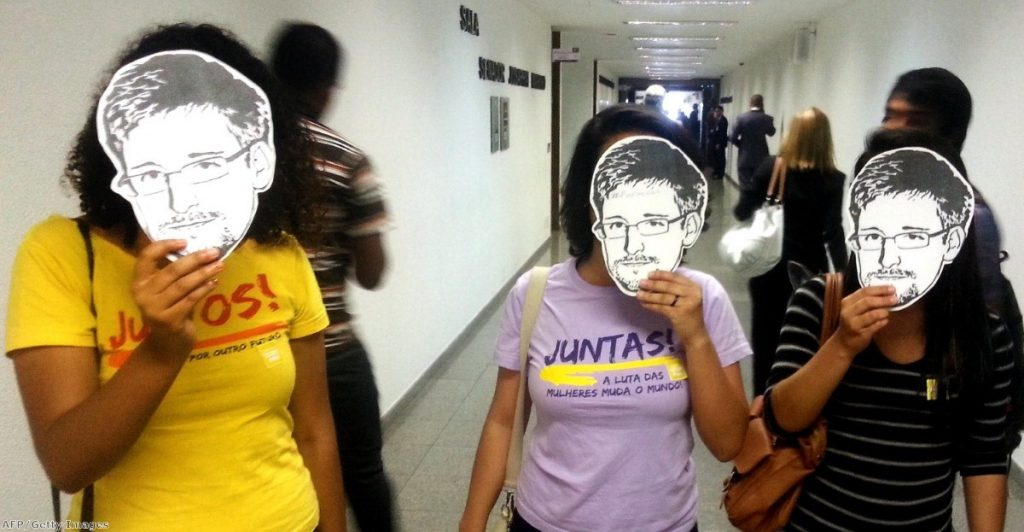 Members of the Youngs Together activist group pose with masks of Edward Snowden during a public hearing of Brazil-based Guardian reporter Glenn Greenwald at the Brazilian Senate's foreign relations committee earlier this month.