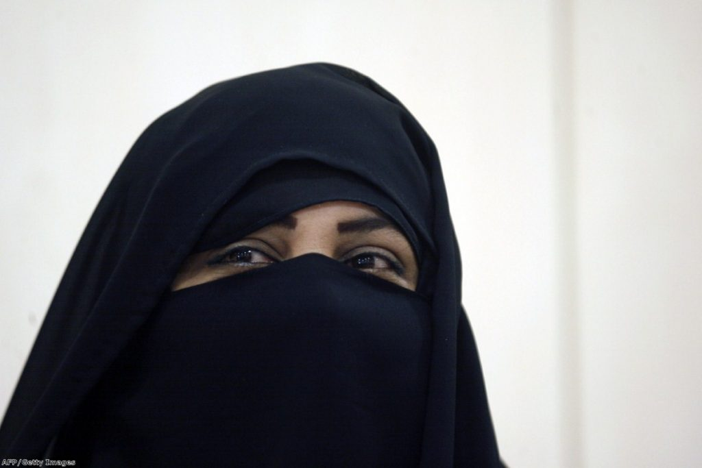 A candidate stands for election in Kuwait wearing the niqab. in Europe, the full-face veil has been a constant source of controversy.