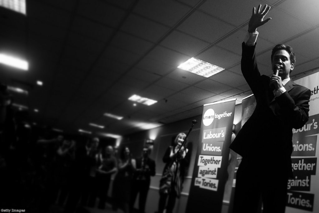 Miliband greets delegates during a fringe event at the Labour party conference