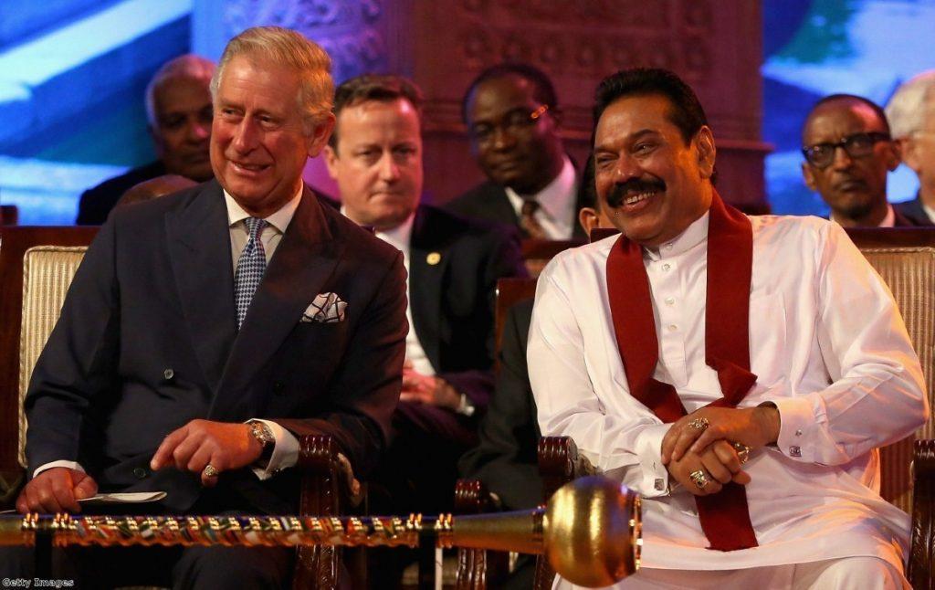 Cameron looks on as Prince Charles and Sri Lankan president Rajapaksa share a joke
