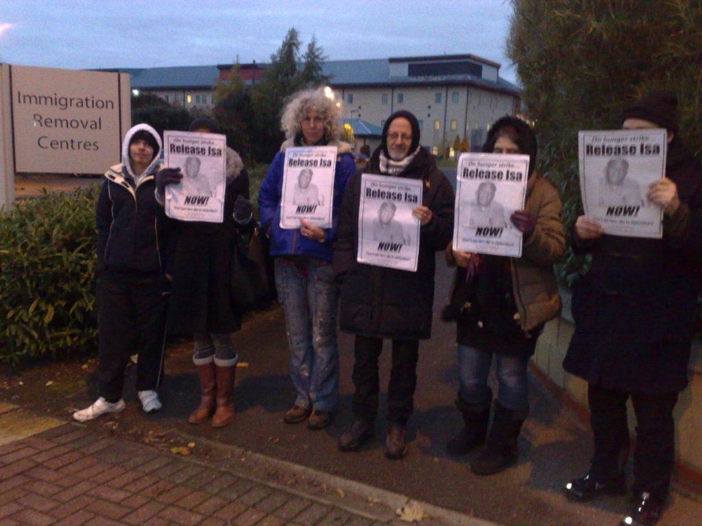 Demonstrators hold a vigil outside Harmondsworth Detention Centre, where Muazu is held