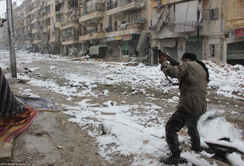A rebel fighter aims his weapon during clashes with pro-government forces in Aleppo last Wednesday