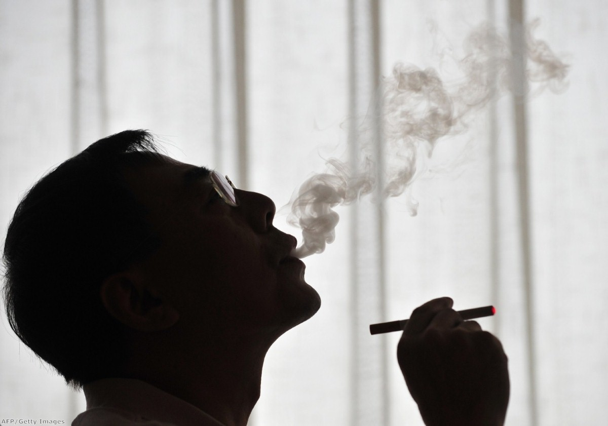 The inventor of the electronic cigarette, Hon Lik, smoking his invention in Beiijng in 2009.