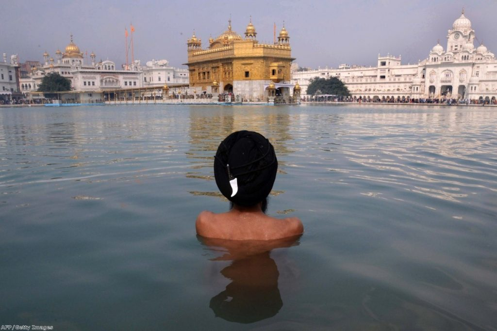 A boy gazes at the Golden Temple at Amritsar