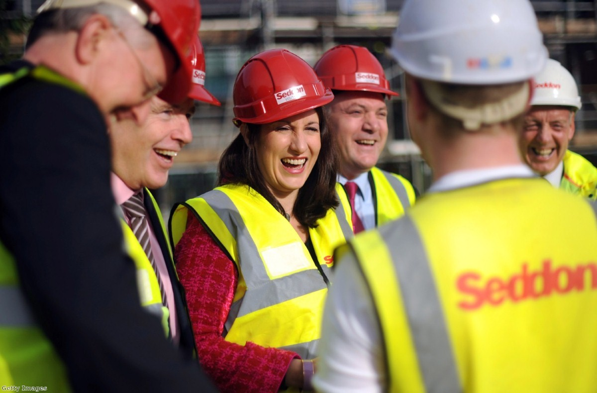 Rachel Reeves enjoys a joke with Ed Balls on a visit to a construction site. The shadow work and pensions secretary is making her first major speech in the post today.