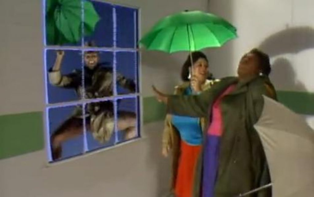 A still from the Weather Girls' It's Raining Men takes a visual interpretation of the song to extremes