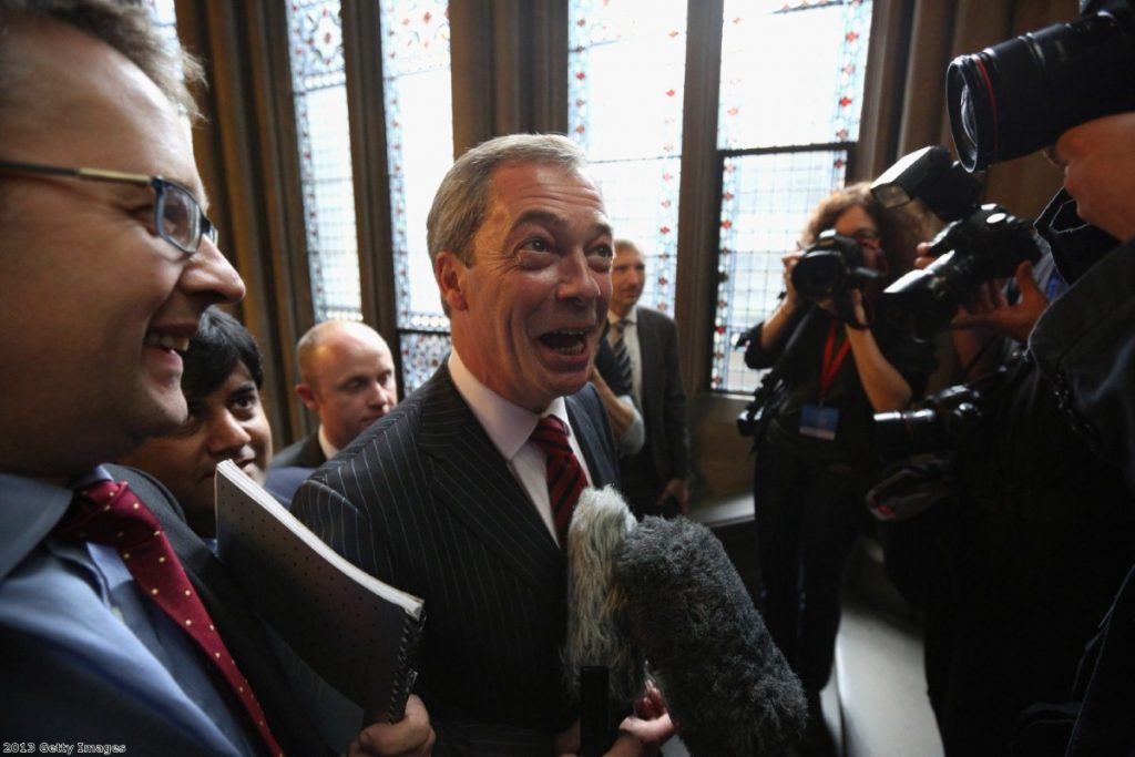 Nigel Farage greeted as he arrives at the Conservative party conference