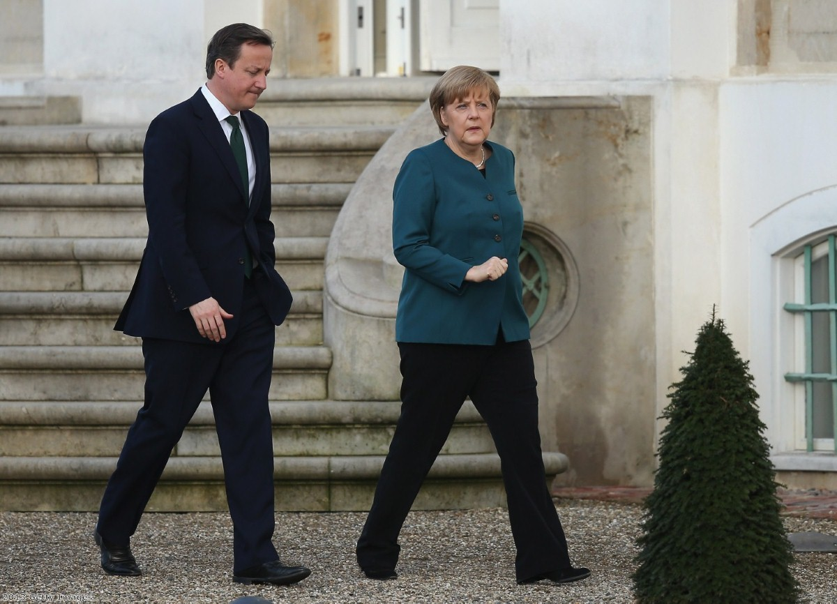 Cameron meeting Merkel in Germany last year