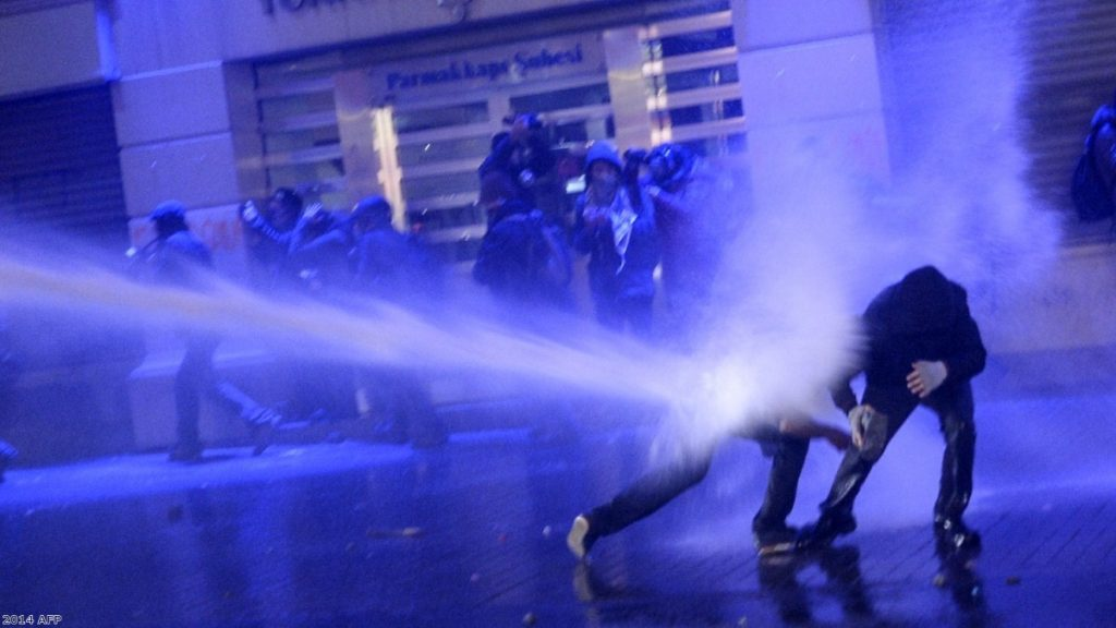 Police fire water cannon at anti-government protesters in Turkey.