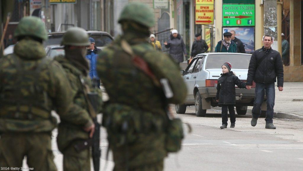 Heavily-armed soldiers maintain watch in a street in Simferopol, Ukraine