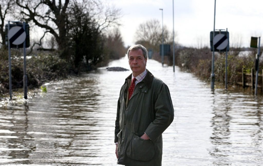 Farage poses for a photograph in front of flood water at Burrowbridge on the Somerset Levels last month