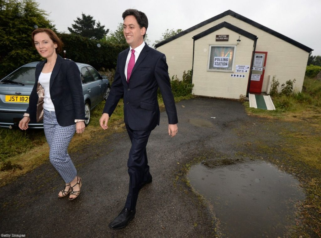 Miliband and wife Justine leave Sutton Village Hall after voting this morning