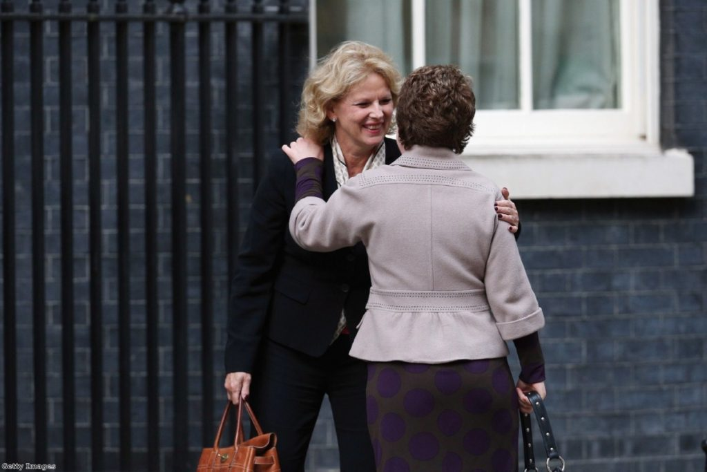 Soubry congratulates a colleague as she arrives at Downing Street during the 2013 reshuffle