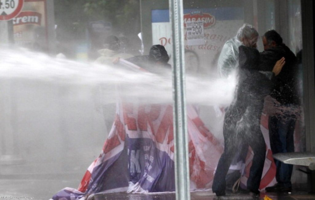 Anti-government protesters hit by water cannon in Turkey.
