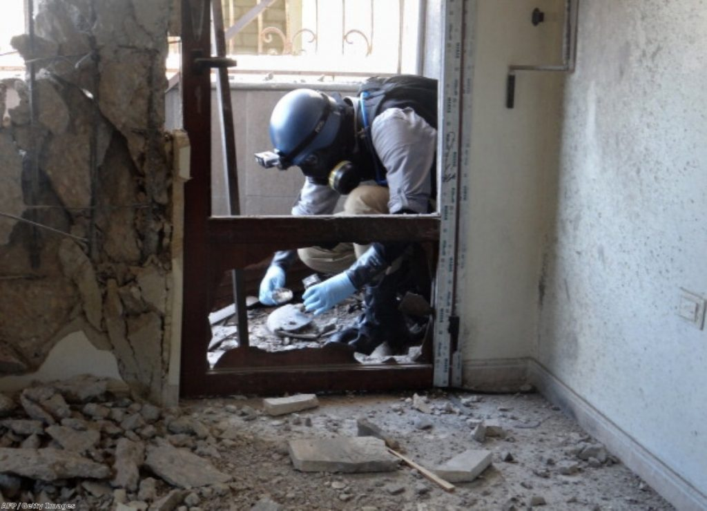 UN inspector tests the site of a suspected Syrian chemical attack.