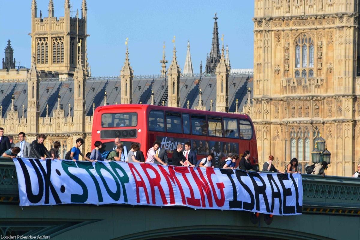 A 75-foot banner is unfurled along Westminster Bridge