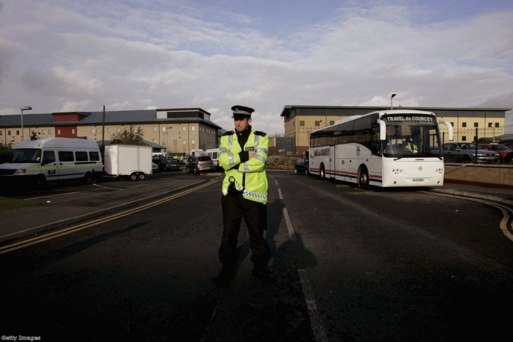 A police officer stands guard at the entrance to Harmondsworth following clashes between police and detainees in 2006