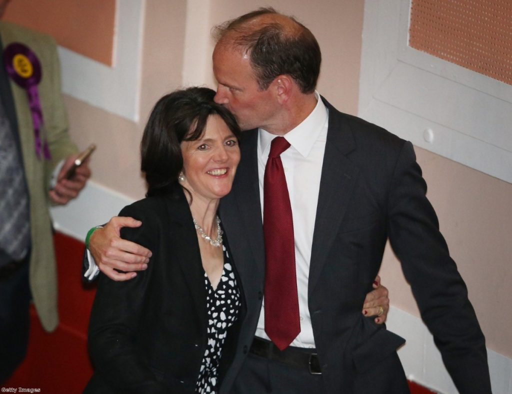 Carswell kisses his wife during a dramatic night in British politics which saw him win Clacton for Ukip