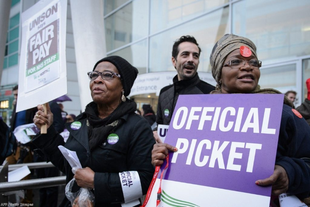 NHS workers strike outside University College Hospital in central London