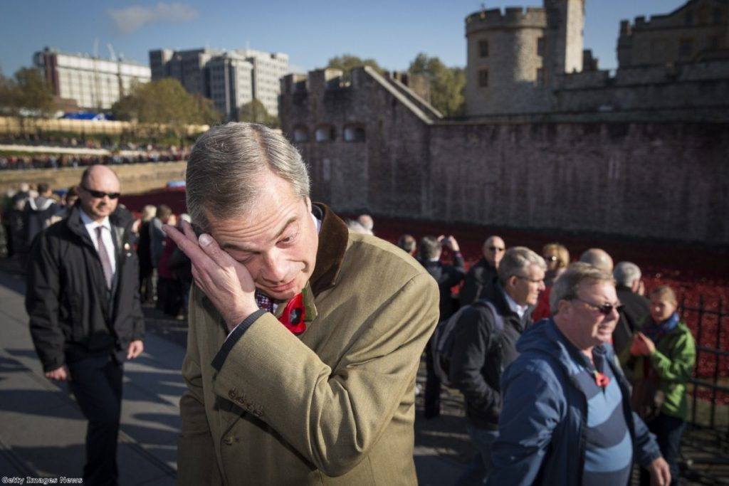 Farage wipes a tear from his eye after visiting the poppy exhibit at the Tower of London