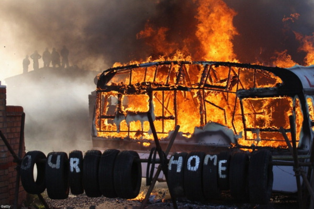 Flames engulf a caravan during the Dale Farm travellers camp eviction in 2011