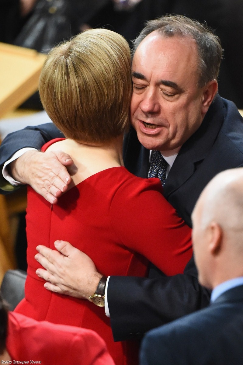 Salmond embraces his successor, Nicola Sturgeon, after he steps down following the failure of the Yes campaign