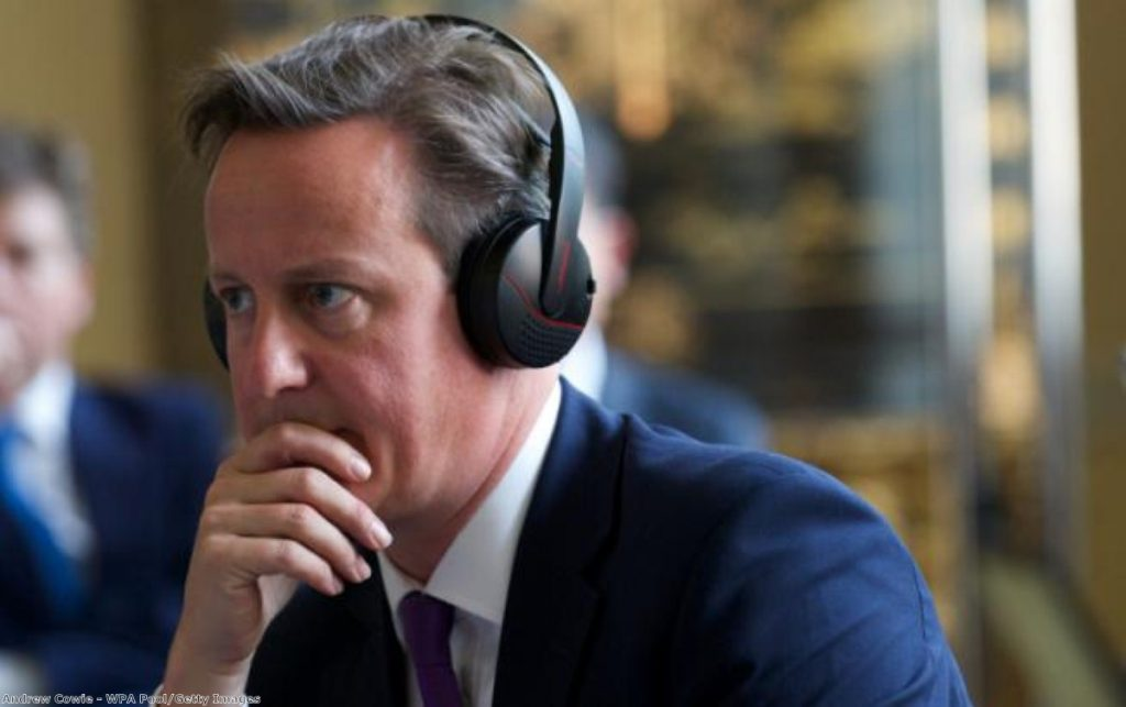 David Cameron listening to some big tunes. Or, maybe, a translator.