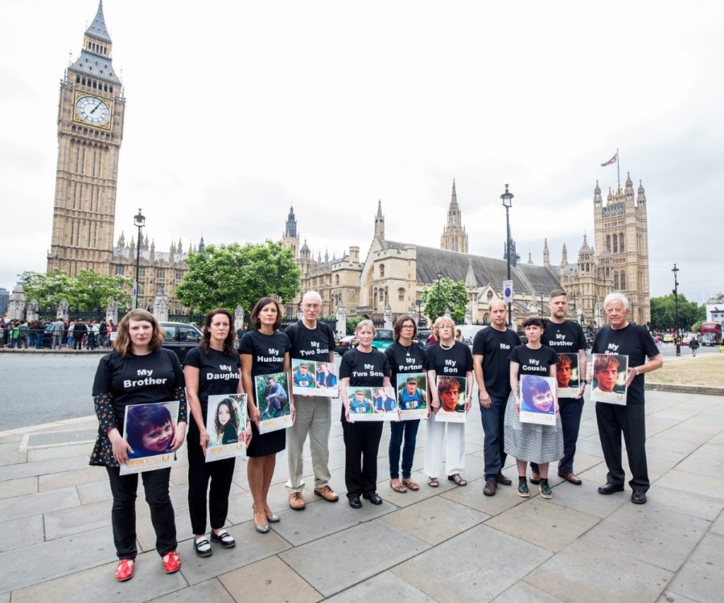 Families broken by Britain's drug laws outside parliament demanding reform