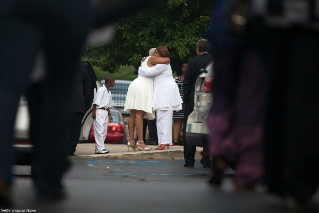 Sandra Bland's sister, Shavon, is embraced before her funeral service at DuPage African Methodist Episcopal Church in Illinois last Saturday